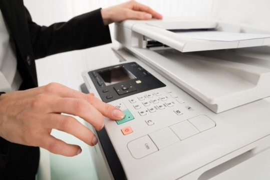 Photocopier-Buttons-Pressed-To-Begin-Copying-Task.jpg