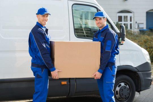 Movers-Carrying-Cardboard-Box-Beside-Truck.jpg