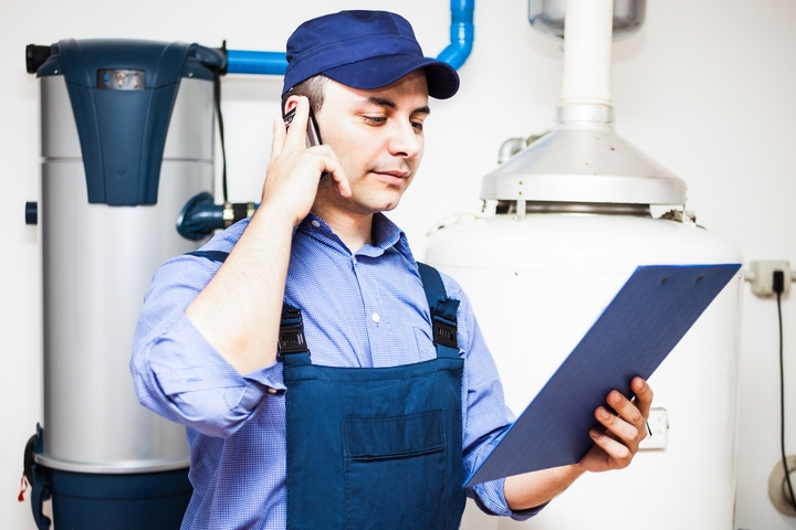 HVAC-Technician-Checks-Clipboard-For-Furnace-And-Heating-Boiler.jpg