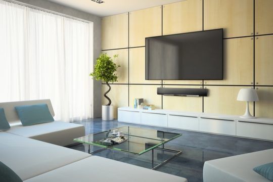 Apartment-Condo-With-Television-And-White-Sofa-Couches.jpg