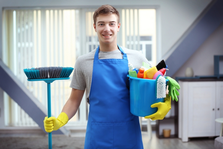 Cleaning-Professional-With-Broom-And-Blue-Bucket-of-Supplies.jpg