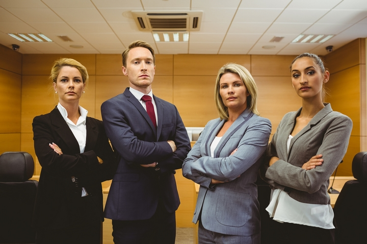 Law-Team-With-Four-Lawyers-Crossing-Arms-In-Courtroom.jpg