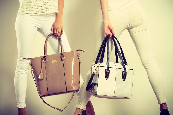 Brown-Leather-Handbags-Carried-By-Women-In-White-Pants.jpg
