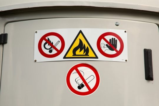Safety-Hazard-Labels-Warning-Inflammable-Properties-On-Industrial-Container.jpg