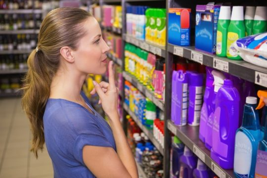 Shopping-Woman-Looks-At-Product-Pacakging-Designs-In-Store.jpg